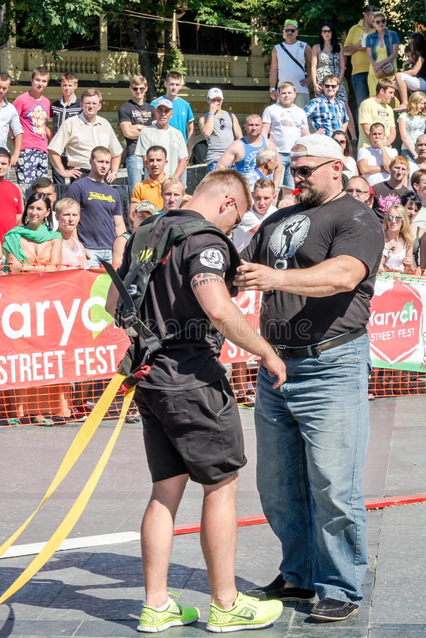Yarych street Fest 2015. The World's Strongest Man Vasyl Virastuk referee strongmen competitions. Lviv, Ukraine - July 2015: Yarych street Fest 2015. The World's stock image