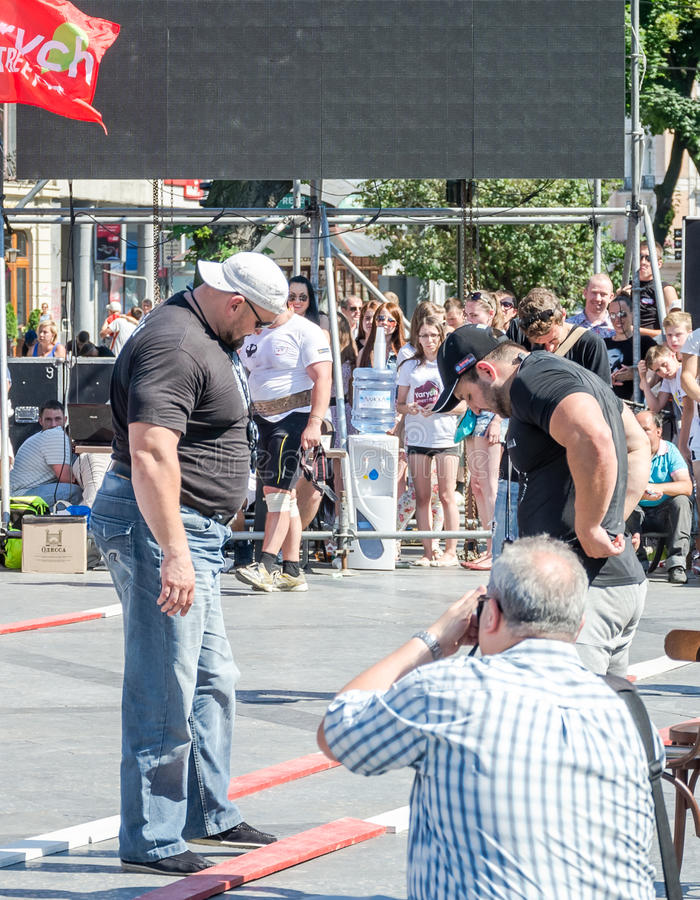 Yarych street Fest 2015. The World's Strongest Man Vasyl Virastuk referee strongmen competitions. Lviv, Ukraine - July 2015: Yarych street Fest 2015. The World's stock photos