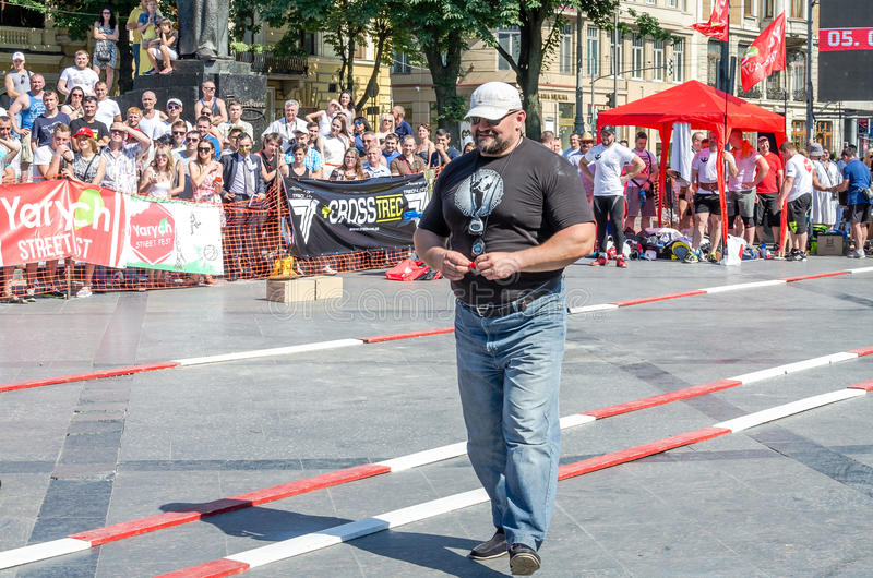 Yarych street Fest 2015. The World's Strongest Man Vasyl Virastuk referee strongmen competitions. Lviv, Ukraine - July 2015: Yarych street Fest 2015. The World's royalty free stock photography