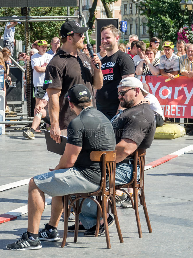 Yarych street Fest 2015. The World's Strongest Man Vasyl Virastuk referee strongmen competitions. Lviv, Ukraine - July 2015: Yarych street Fest 2015. The World's royalty free stock images