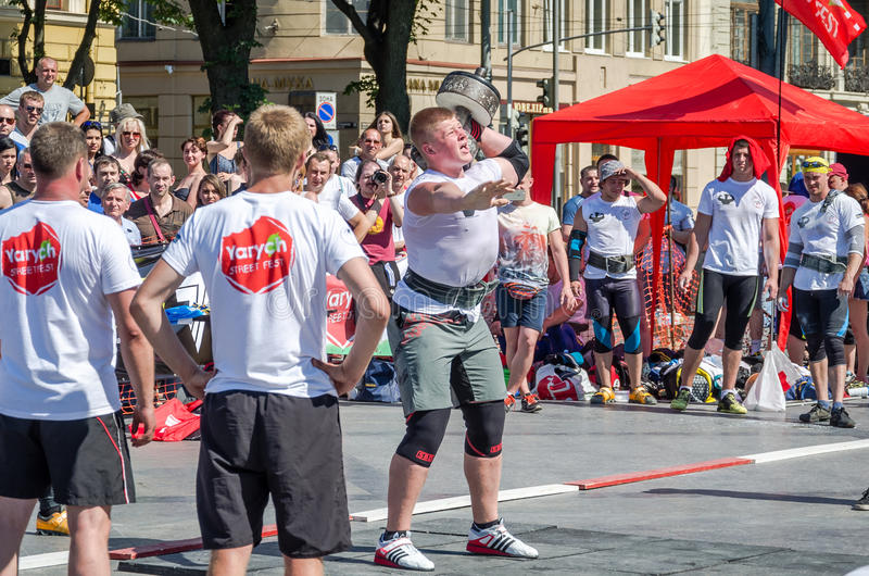 Yarych street Fest 2015. The World's Strongest Man Vasyl Virastuk referee strongmen competitions. Lviv, Ukraine - July 2015: Yarych street Fest 2015. The World's royalty free stock photos
