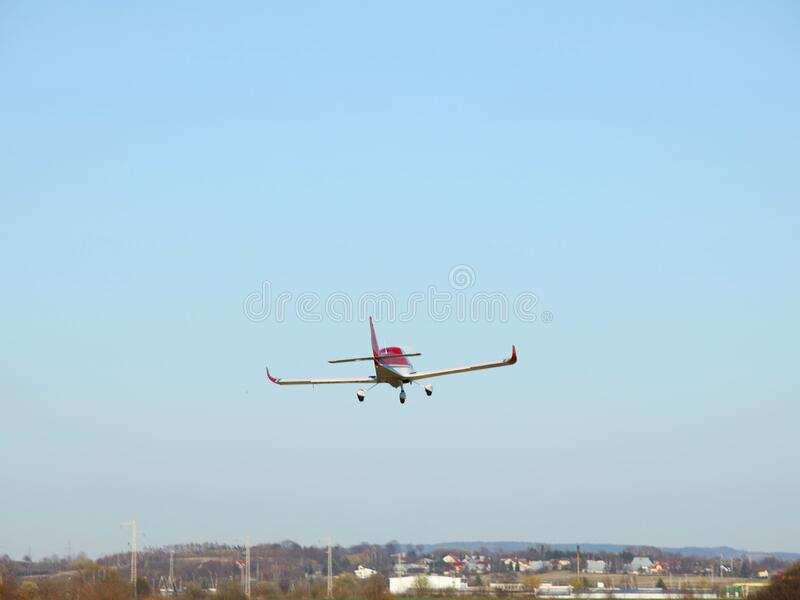 Yaslo, Poland - 7 9 2019: A light sport turboprop aircraft flies across the sky among the rainy clouds. Landing in difficult. Weather conditions. Meteorology stock image
