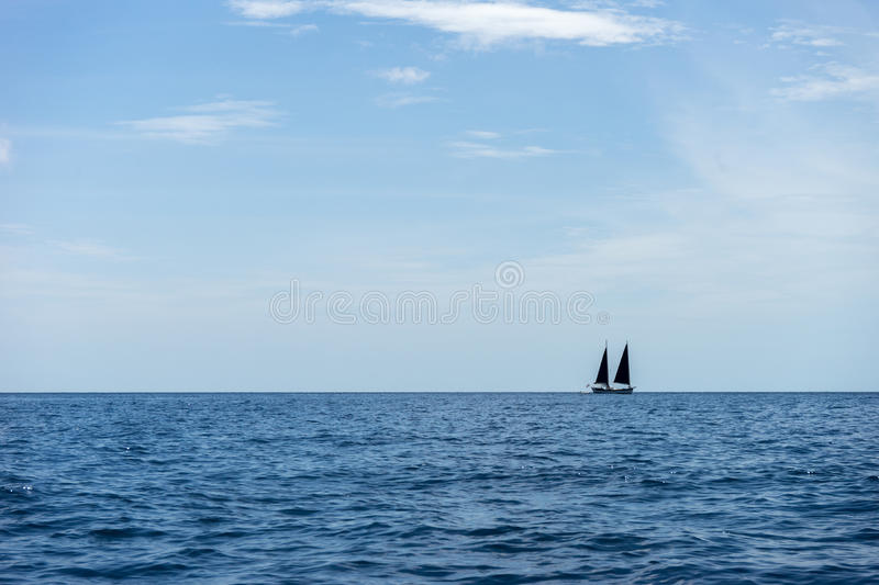 Yatch in the Blue Ocean royalty free stock photography