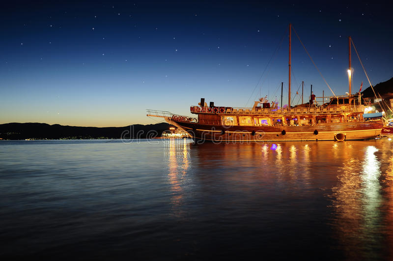 Yatch at night stock photography