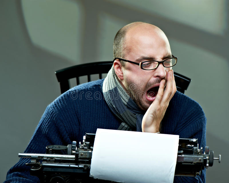 Yawning bald man in glasses stock photo