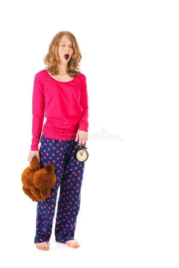 Yawning girl is going to sleep royalty free stock photos