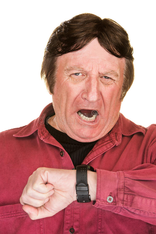 Yawning Man Looking At Watch stock images