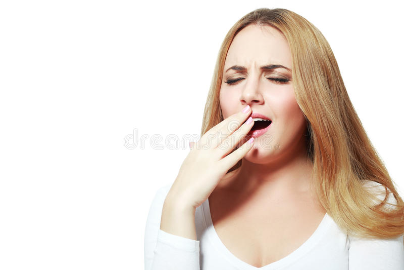 Yawning tired woman royalty free stock photos