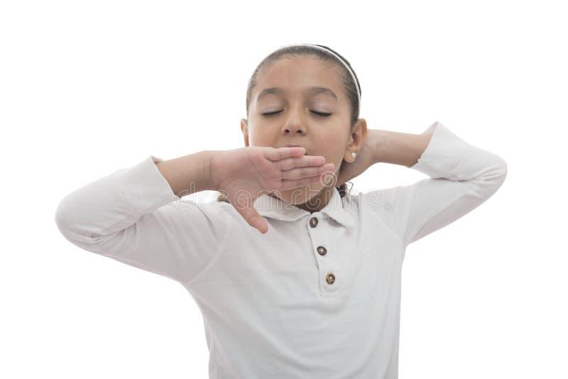 Yawning Young Girl. Young Yawning Sleepy Girl Isolated on White Background stock images