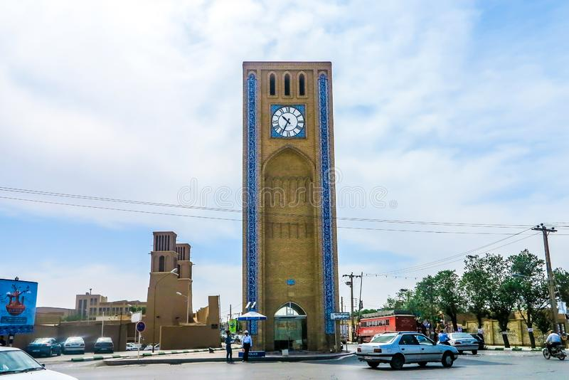 Yazd Clock Tower 01. Yazd Market Saat Square Clock Tower with Picturesque Breathtaking Busy Traffic stock photo