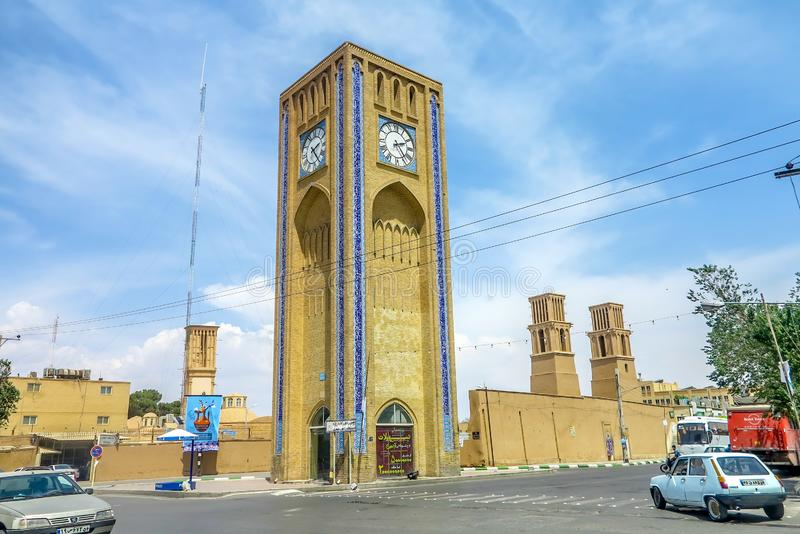 Yazd Clock Tower 02. Yazd Market Saat Square Clock Tower with Picturesque Breathtaking Busy Traffic royalty free stock photo