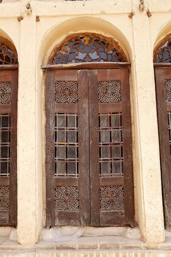 Yazd. One of the doors at the Khan-e Lary house at Yazd, Iran. The Khan-e Lary House is the mansion of a welthy merchant family. Built in 1860 it is a fine stock photography