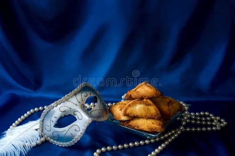 Żydowski wakacje Purim hamantaschen, karnawał maska i obraz royalty free