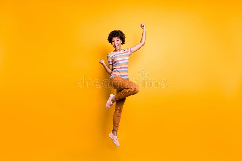 Yeah discounts. Full length photo of crazy funky brunette wavy hair mulatto girl jump raise fists scream win spring. Yeah discounts. Full length photo of crazy stock images