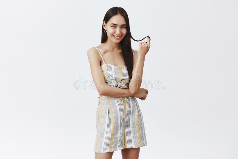 Yeah I am flirting with you. Good-looking fashionable and feminine woman in summer outfit playing with hair strand royalty free stock photo