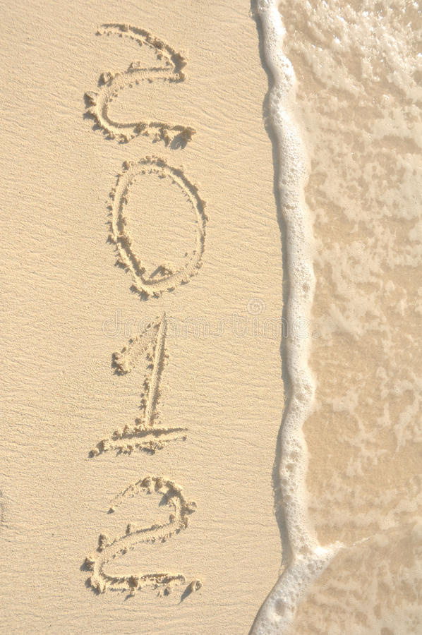 Download The Year 2012 Written In Sand On Beach Stock Photo - Image of foamy, handwriting: 19065486