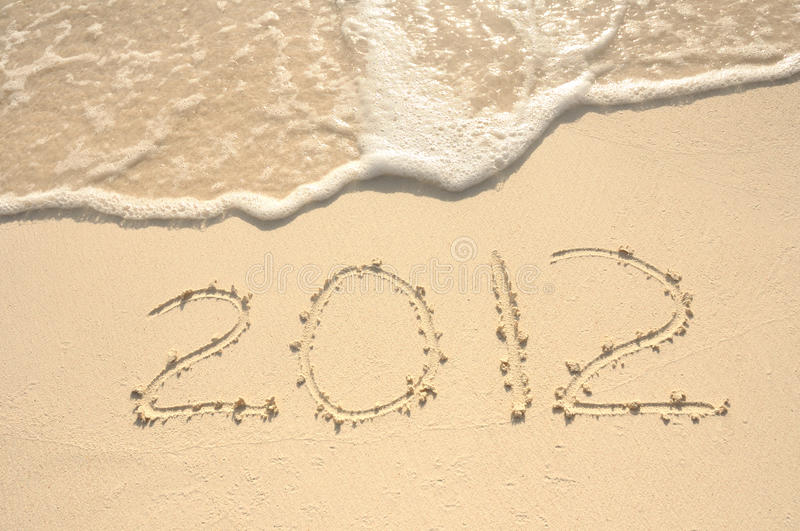 The Year 2012 Written In Sand On Beach Royalty Free Stock Images