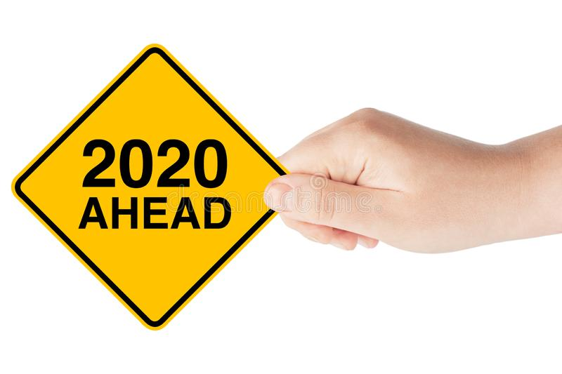 2020 Year Ahead Traffic Sign in Woman`s Hand. On a white background royalty free stock image