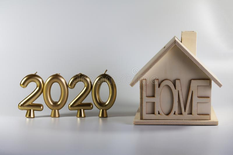 2020 year of candles and a homemade wooden house stock photos