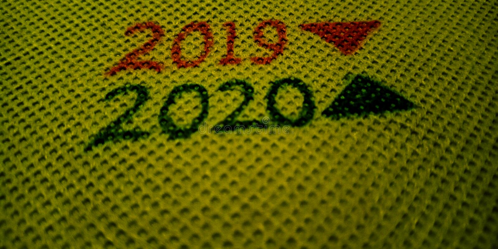 Year 2019 and 2020 displayed with share buying selling concept on golden background stock images