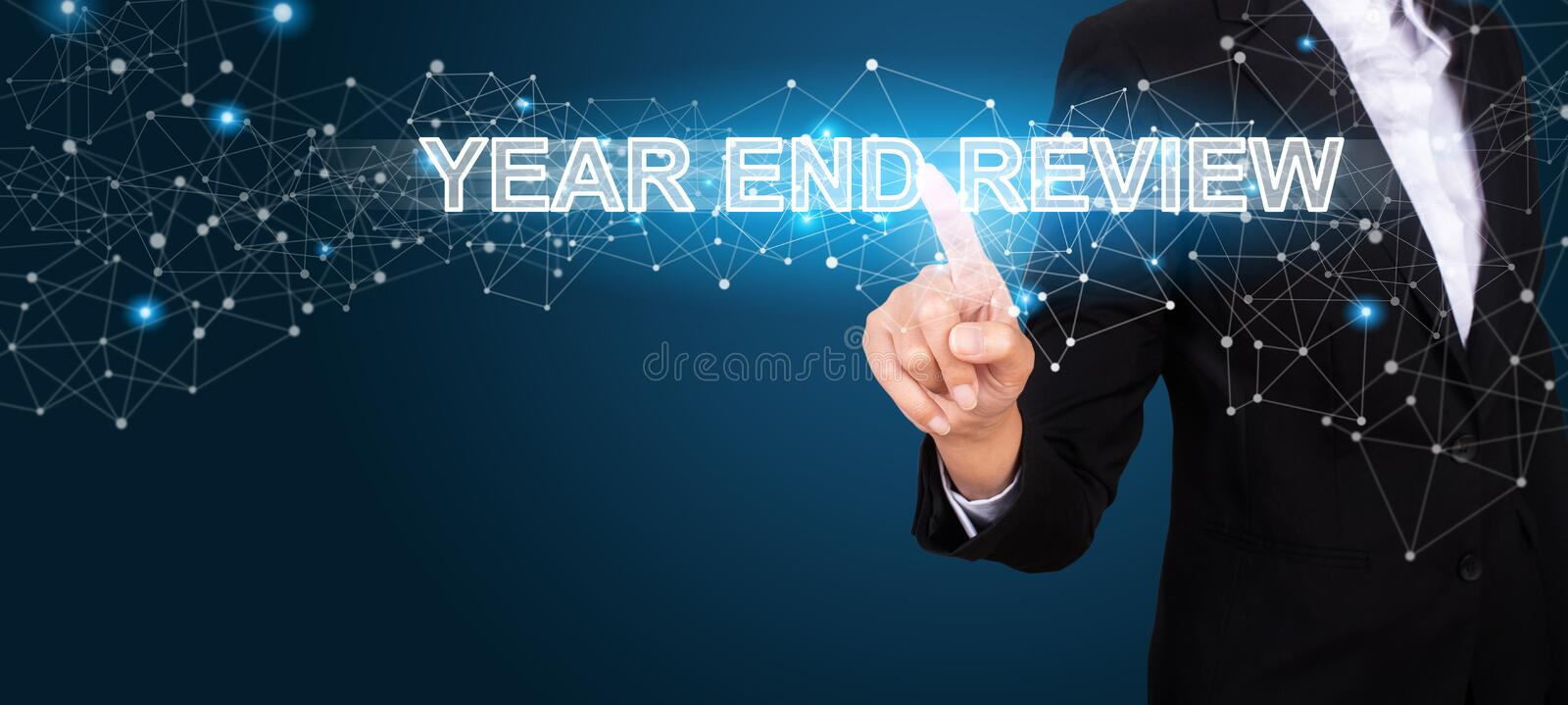 Year End Review concept with Hand of business pressing a button royalty free stock photo