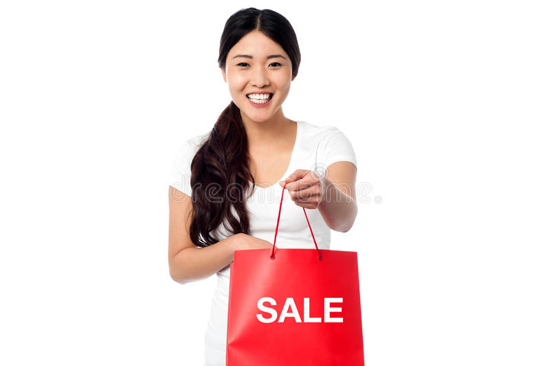 Year end sale begins!. Young pretty girl holding shopping bag. Year end sale begins stock images