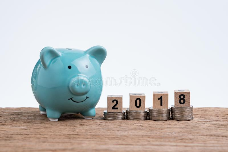 Year 2018 financial plan with piggy bank and coins stacked on to royalty free stock photos