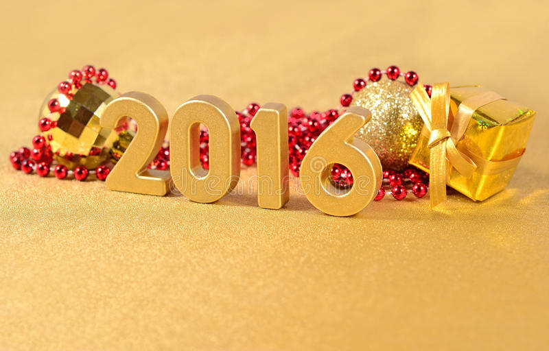 2016 year golden figures and Christmas decorations stock photos