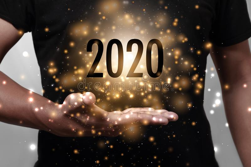 Year 2020 with hand stock images