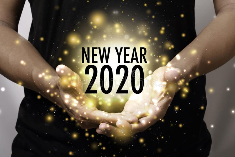 Year 2020 with hand stock image