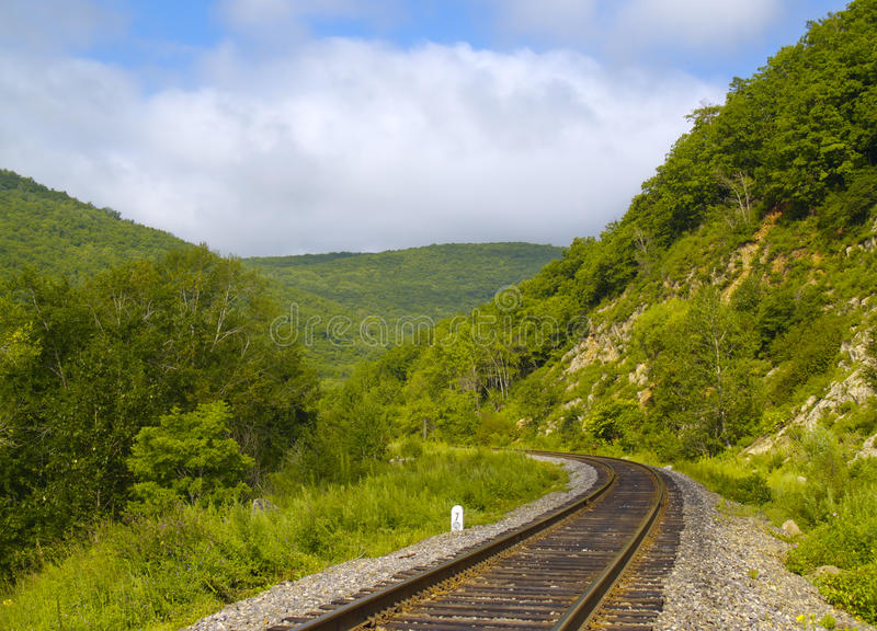 Year landscape with railway line and cloudy sky royalty free stock photo
