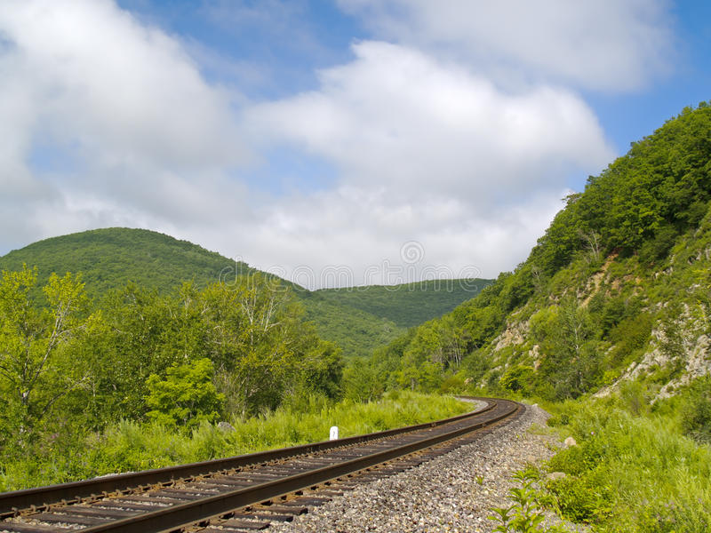 Year landscape with railway line and cloudy sky royalty free stock photography