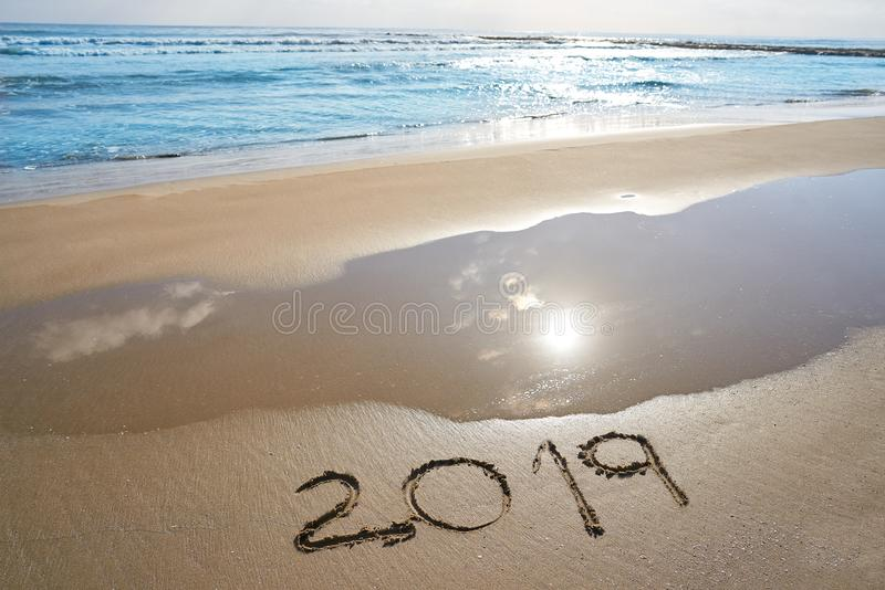 year 2019 numbers spell written on beach stock images