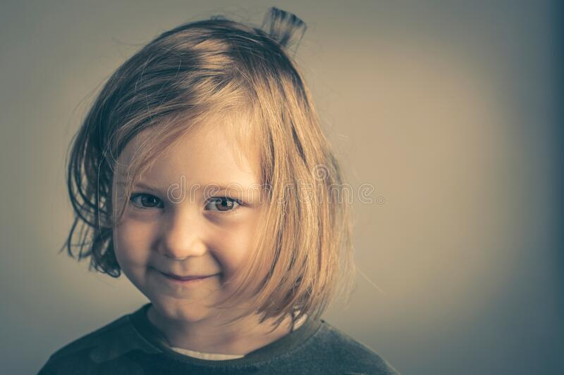 4 year old blond girl with messy hair stock image