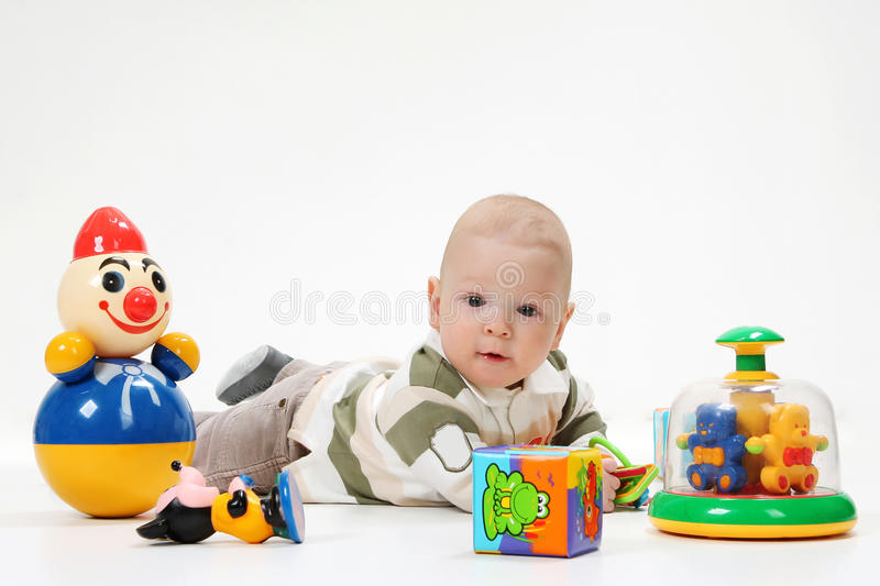 Year-old child with toys on a white background stock photography
