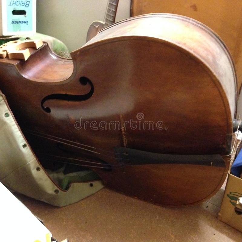 100 Year Old Double Bass Guitar. The double bass or simply the bass and numerous other names is the largest and lowest-pitched bowed string instrument in the stock image