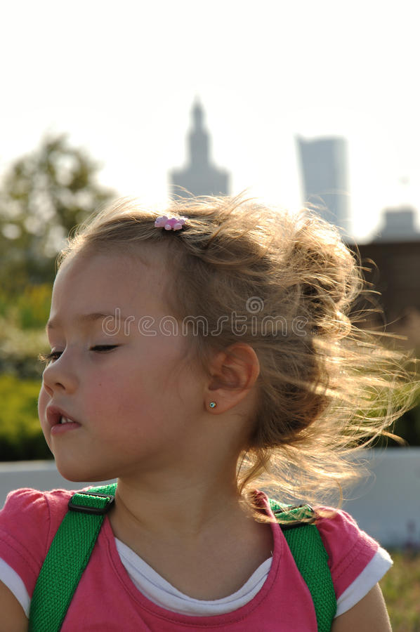 4 year old girl in centre of Warsaw stock photography