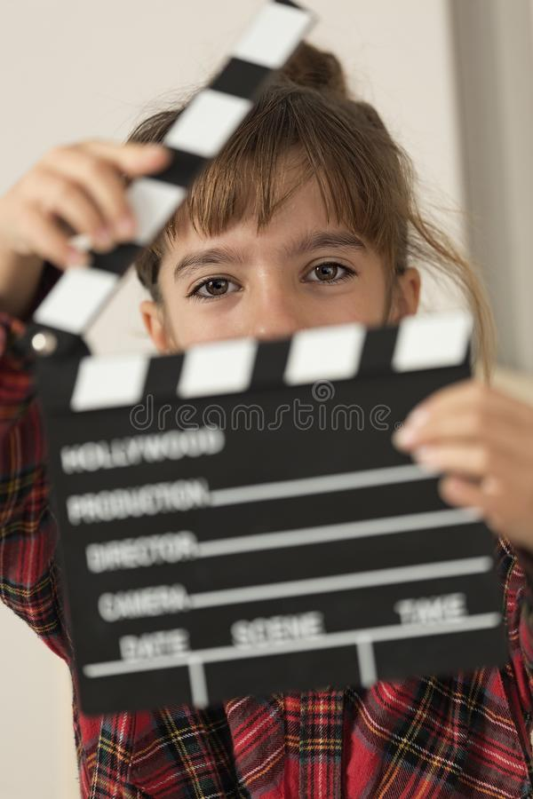10-year-old girl with a clapboard of a hundred in her hands. royalty free stock images