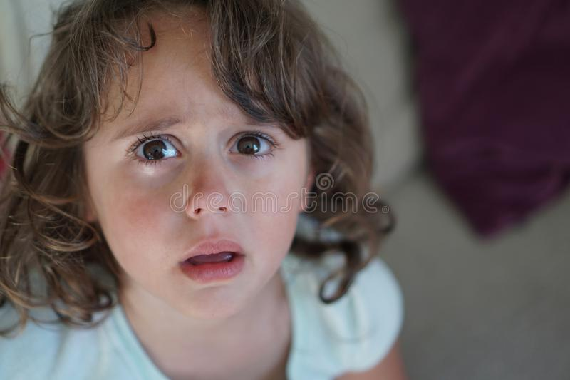 A 4-year-old girl cries after she has been shouted by her parents. A 4-year-old girl cries desperately after she has been shouted by her parents, hysteria stock images