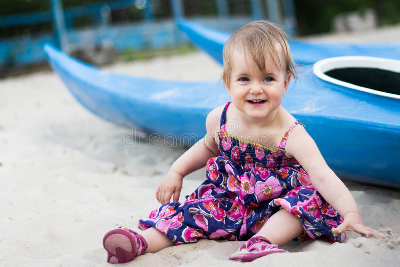 Year-old girl near a canoe stock image