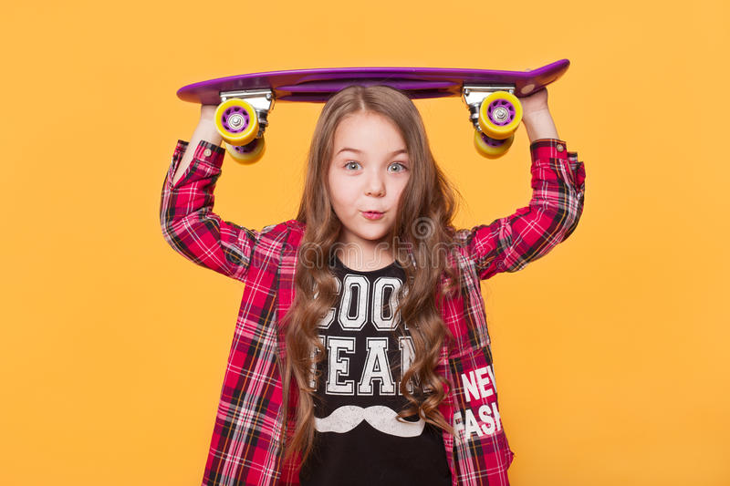6 year old girl wearing hipster casual clothes stock images