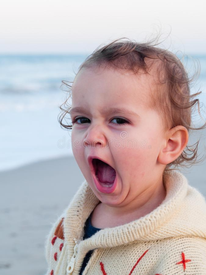 2 year old girl who yawns stock photography