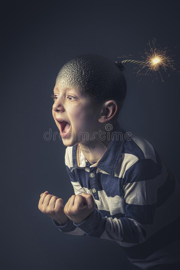 6 year old kid caucasian boy near to explode. Angry caucasian child with bomb shaped head about to explode. Concept of anger and uncontrolled emotions. Vertical royalty free stock image