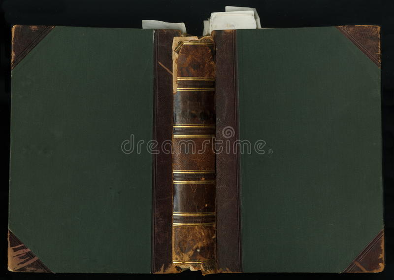 200 Year old leather book cover. bound in leather and cloth, with bookmark. Antique Vintage Leather Book Cover. Old and ornate book cover. Old dark green fabric stock photography