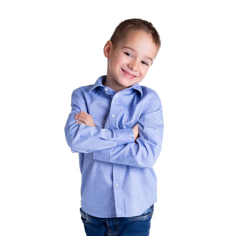 5-6 year old smart boy standing with his arms crossed. Childhood, lifestyle and education concept.  royalty free stock photos