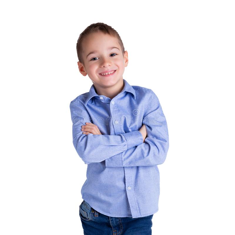 5-6 year old smart boy standing with his arms crossed. Childhood, lifestyle and education concept.  royalty free stock image