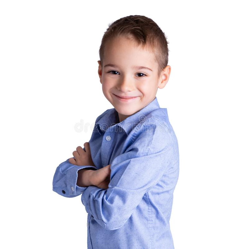 5-6 year old smart boy standing with his arms crossed. Childhood, lifestyle and education concept.  stock photography