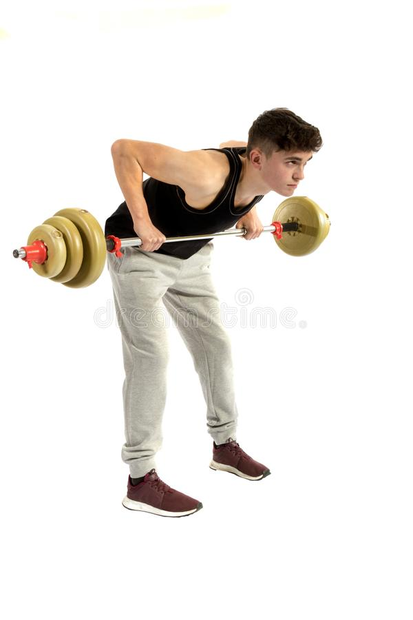 18 year old teenage boy exercising with weights stock images