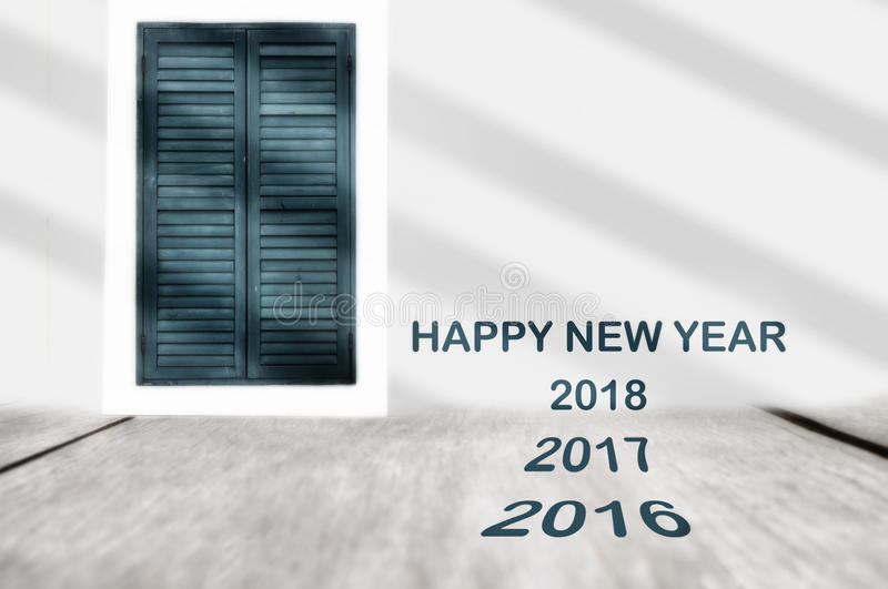 Year 2016 2017 2018 on plank and classic window background stock image