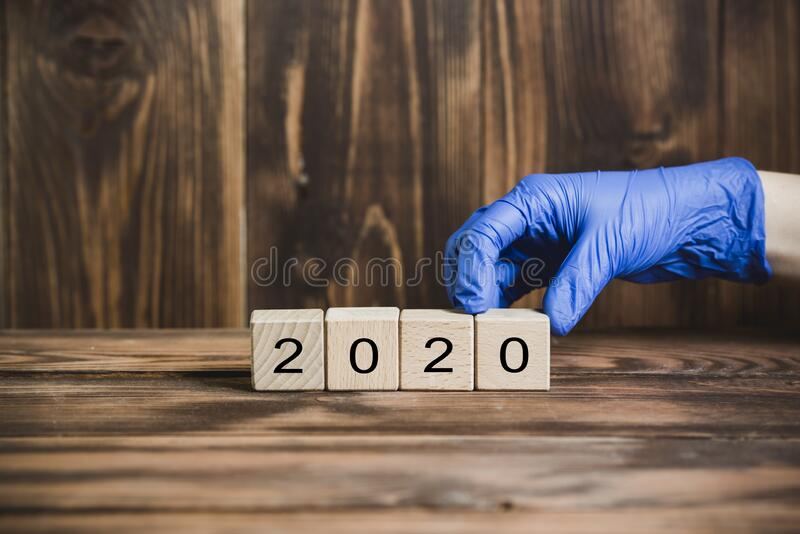 The year 2020 in protective gloves stock photo